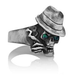 RG100-B The Gangster Skull Ring (Front Side View) in Sterling Silver with Green Stones, designed by Steve Soffa