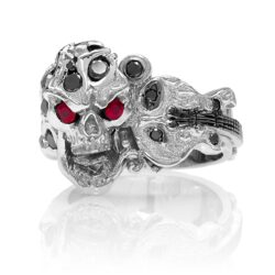 RG1008-B The Rock Star Skull Ring (Front View) in White Gold with Black Diamonds, White Diamonds and Rubies, designed by Steve Soffa