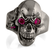 RG102-BK-RD The Player skull ring is cast in 20 grams 999 rhodium plated Sterling Silver with red stones. From the Black Collection, designed by Steve Soffa