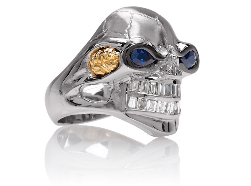 RG3020WH-B Monstrous Max Skull Ring (Front Side View) in White Gold Blue Sapphire eyes, designed by Steve Soffa
