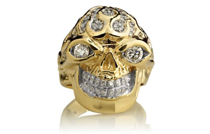 RG3022YG-A Blazing Bruno Skull Ring (Front View) in Yellow Gold with White Diamonds, designed by Steve Soffa
