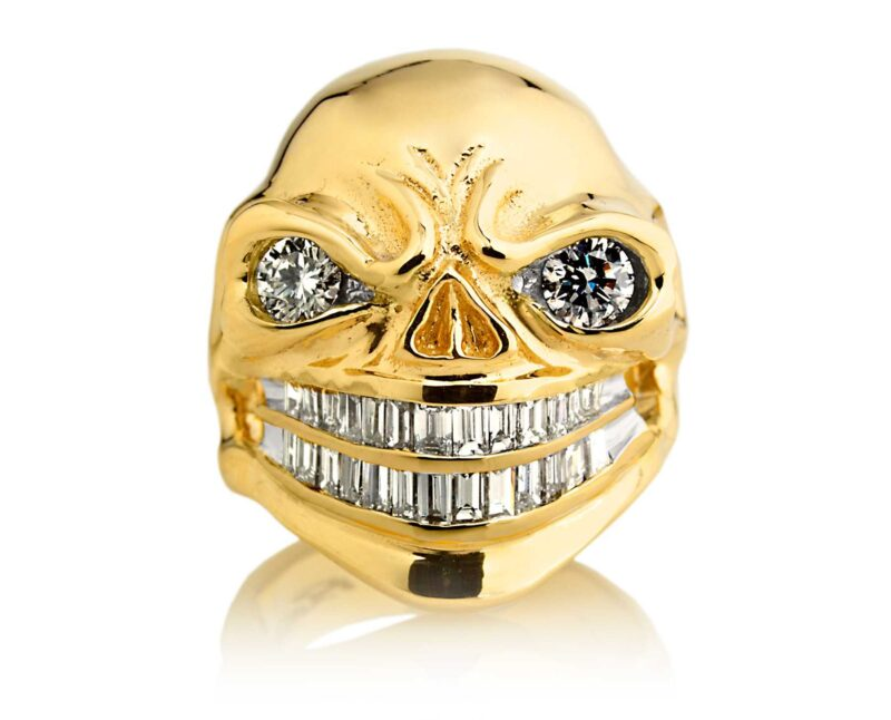 RG3024YG Sinister Sid Skull Ring (Front View) in Yellow Gold with White Diamonds, designed by Steve Soffa