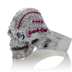 RG1006 The Freedom Rider Jewelry Skull Ring (Left Side) in White Gold with White Diamonds, Red Rubies and Blue Sapphire (Diamond Collection), designed by Steve Soffa