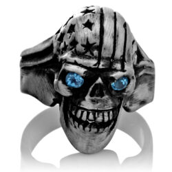 RG106-A The Freedom Rider Jewelry Skull Ring (Front View) in Silver with Blue Stones, designed by Steve Soffa