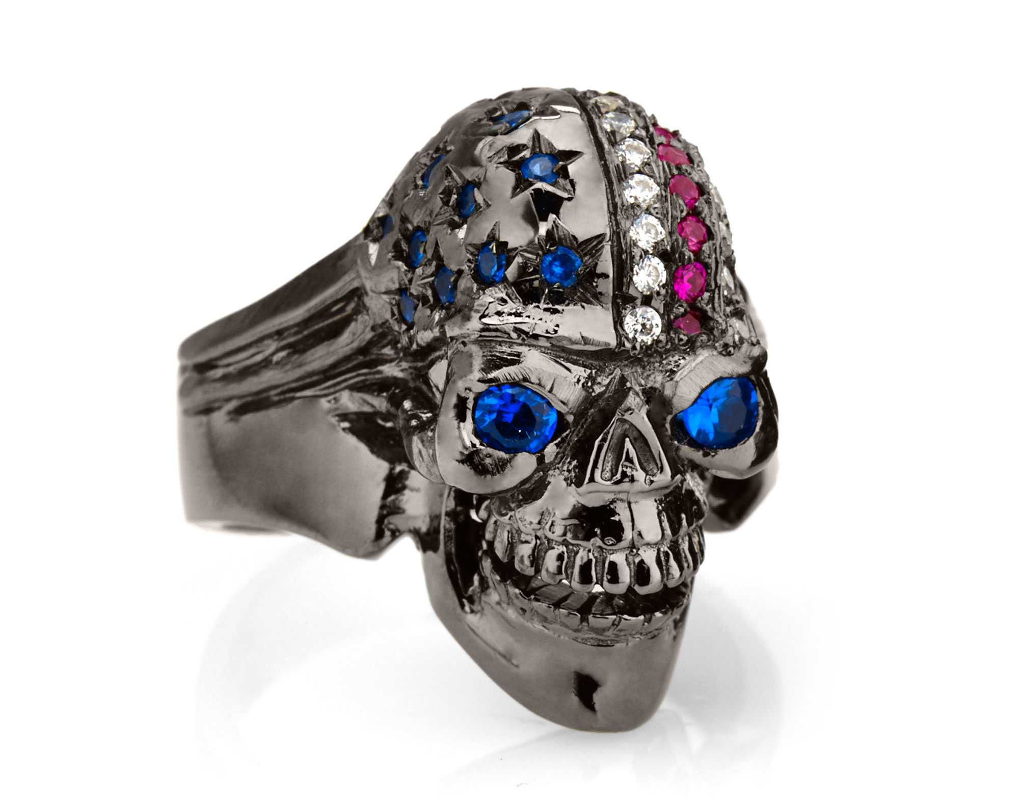RG106BK-BL The Freedom Rider Skull Ring (Right Front View) in Rhodium Plated Sterling Silver in Blue Stones, with Blue, White & Red (Black Collection), designed by Steve Soffa