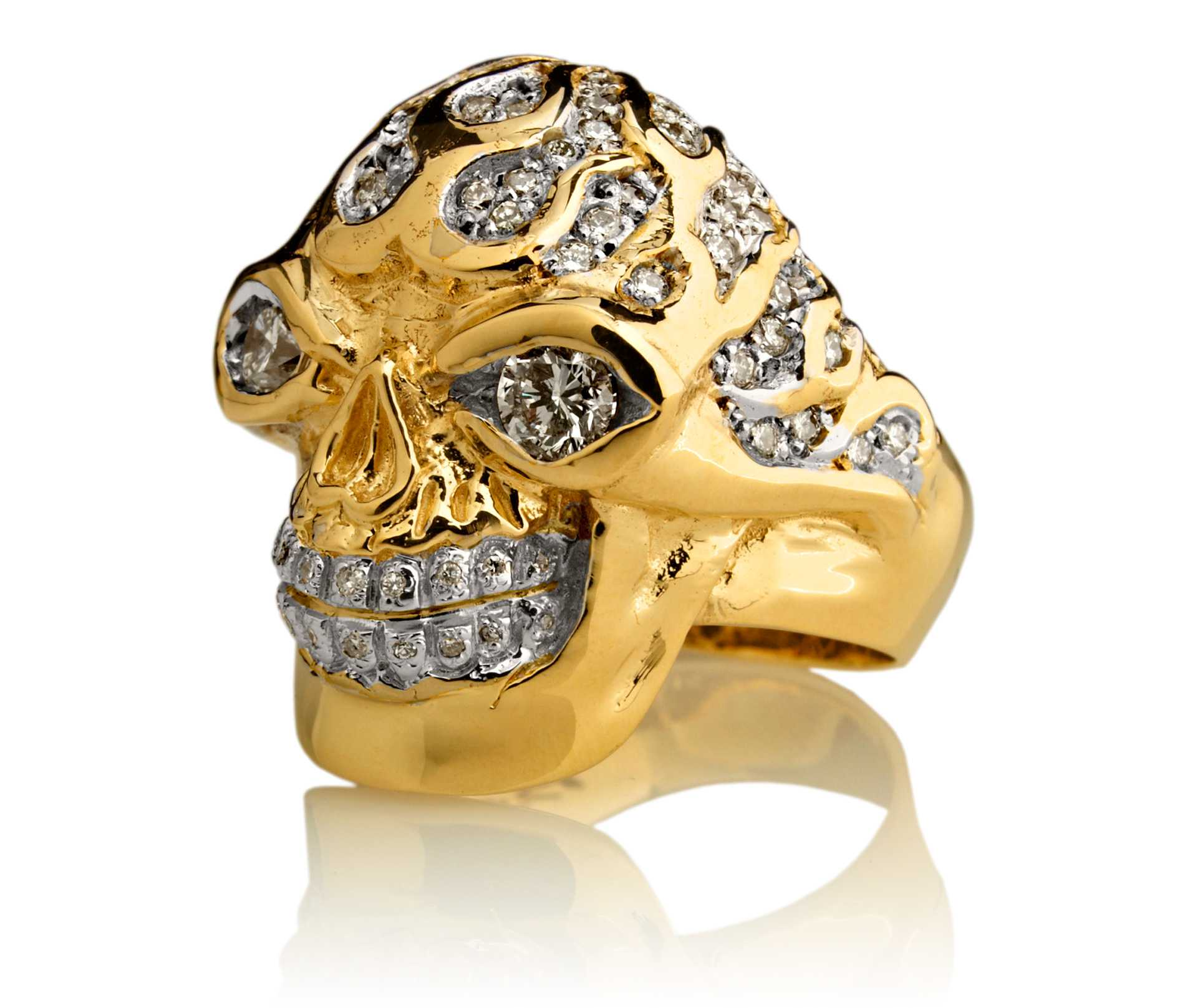blazing bruno skull ring in yellow gold with white