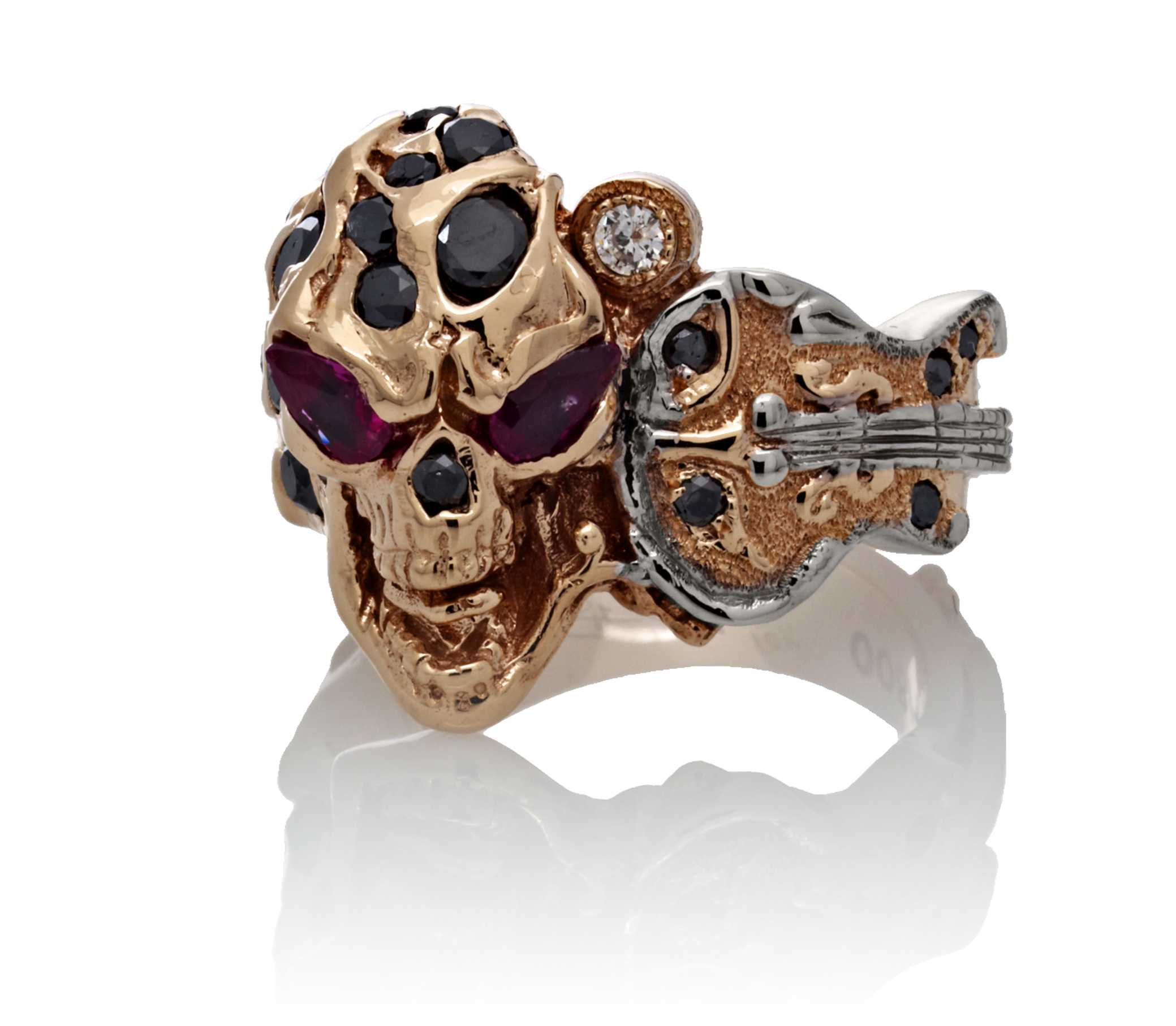 RG1008-A The Rock Star Skull Ring (Front View) in Rose/White Gold, with Black/White Diamonds and Rubies, designed by Steve Soffa