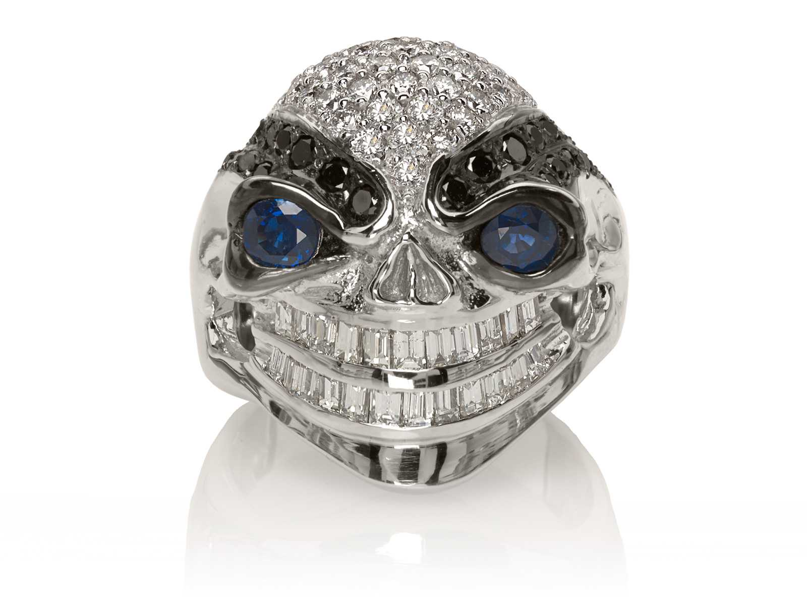 RG3028 Wicked Willy skull ring (Front View) in White Gold with White & Black Diamonds, Blue Sapphires, designed by Steve Soffa