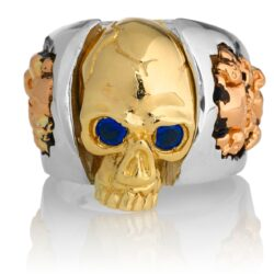 RG1030YGSIL-B Judge and Jury Skull Ring (Front View) in Yellow Gold and Sterling Silver with Blue Sapphires and White Diamonds, designed by Steve Soffa